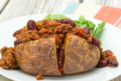 Baked potato filled with Chili con Carne Royalty Free Stock Photos
