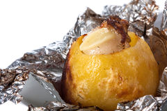 Baked potato in foil. Isolated on white background Royalty Free Stock Photo