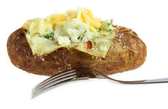 Baked potato with fork isolated Stock Image