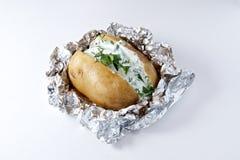 Baked potato with fresh sour. Jacket Potato , Baked Potato with sour with parsley green Royalty Free Stock Photos