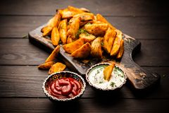 Baked potato fries on wooden table Royalty Free Stock Images