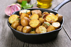 Baked potato in frying pan Stock Photography