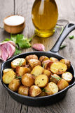 Baked potato in frying pan Royalty Free Stock Image