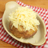 Baked Potato with Grated Cheese Royalty Free Stock Image