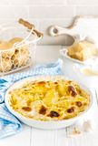 Baked potato gratin with garlic, cream and parmesan cheese. Closeup royalty free stock image