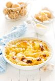 Baked potato gratin with garlic, cream and parmesan cheese. French cuisine stock photos