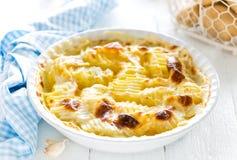 Baked potato gratin with garlic, cream and parmesan cheese Royalty Free Stock Photos