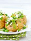 Baked potato with green pea Royalty Free Stock Photo