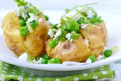 Baked potato with green pea Royalty Free Stock Photography