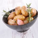 Baked potato and herbs Stock Photography
