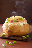 Baked potato in jacket with bacon and cheese Stock Photo