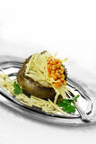 Baked Potato. Baked jacket potato with grated cheese and baked beans with garnish against a white background. Generous accommodation for copy space Stock Images