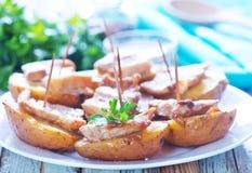 Baked potato with lard Royalty Free Stock Photos