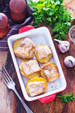 Baked potato with lard. On plate and on a table Stock Photos