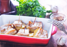 Baked potato with lard. On plate and on a table Stock Images