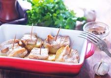 Baked potato with lard Stock Images
