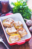 Baked potato with lard. On plate and on a table Royalty Free Stock Photo