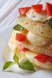 Baked potato with mozzarella, tomato and basil macro vertical Stock Photos