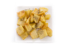 Baked potato with oregano. Detail of baked potato isolated on plate Stock Images