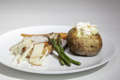 Baked potato with pork loin and shredded apple Royalty Free Stock Image