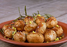 Baked potato. Es with lemon zest and rosemary Stock Images