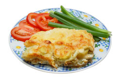 Baked potato pudding with tomato and spring onion Royalty Free Stock Photos