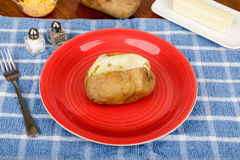 Baked Potato on Red Plate with Butter and Cheese Stock Photography