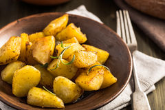 Baked potato with rosemary on plate Stock Photo