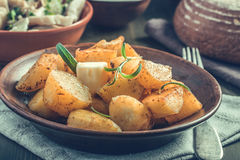 Baked potato with rosemary on plate Royalty Free Stock Photos