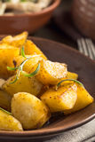 Baked potato with rosemary on plate vertical Stock Photography