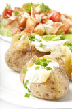 Baked potato and salad Royalty Free Stock Images
