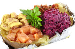 Baked potato with salads on white background Royalty Free Stock Images