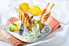Baked potato with salmon Stock Images