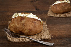 Baked potato with sour cream and a fork Royalty Free Stock Photo