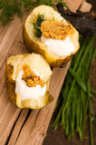 Baked potato with sour cream, mustard and herbs Royalty Free Stock Photography