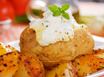Baked potato with sour cream sauce Stock Images