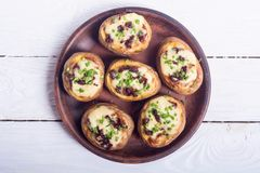 Baked potato stuffed with cheese Royalty Free Stock Photos