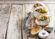 Baked potato stuffed with ham Stock Photography