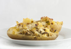 Baked potato stuffed with leek Stock Photography