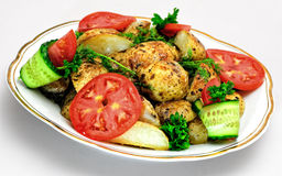 Baked potato with tomatoes, cucumbers and spices Stock Photo