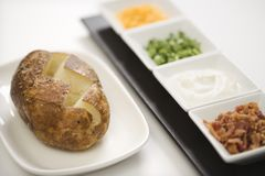 Baked potato with toppings. Royalty Free Stock Photography