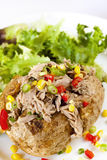 Baked Potato with Tuna. Sweet corn, capsicum and shallots, served with salad Royalty Free Stock Images