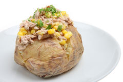 Baked Potato with Tuna. Freshly baked potato filled with tuna, sweetcorn and mayonaise Royalty Free Stock Images