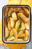 Baked potato wedges in enamel baking dish Royalty Free Stock Photo