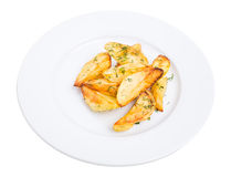 Baked potato wedges with minced dill. Royalty Free Stock Photography