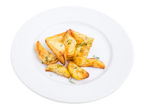 Baked potato wedges with minced dill. Stock Photography