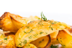 Baked potato wedges with minced dill. Royalty Free Stock Photos