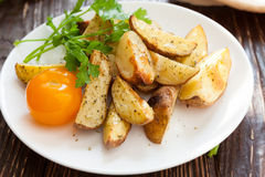 Baked potato wedges in the oven Royalty Free Stock Photos