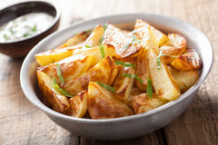 Baked potato wedges with yogurt dip Royalty Free Stock Image
