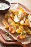 Baked potato wedges with yogurt dip Stock Photography